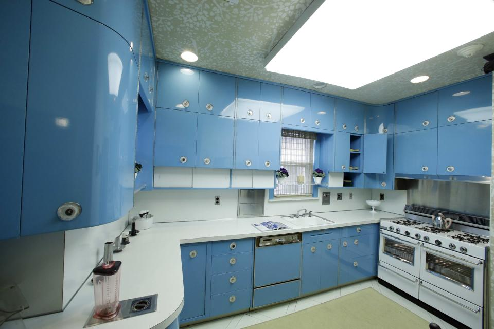The blue kitchen at the Louis Armstrong House Museum is on display Wednesday, Oct. 9, 2013, in the Queens borough of New York. (AP Photo/Frank Franklin II)