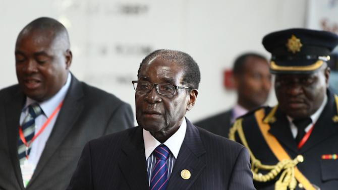 Zimbabwe's President Mugabe arrives for the Ordinary session of the Assembly of Heads of State and Government of the AU at the African Union headquarters in Ethiopia's capital Addis Ababa