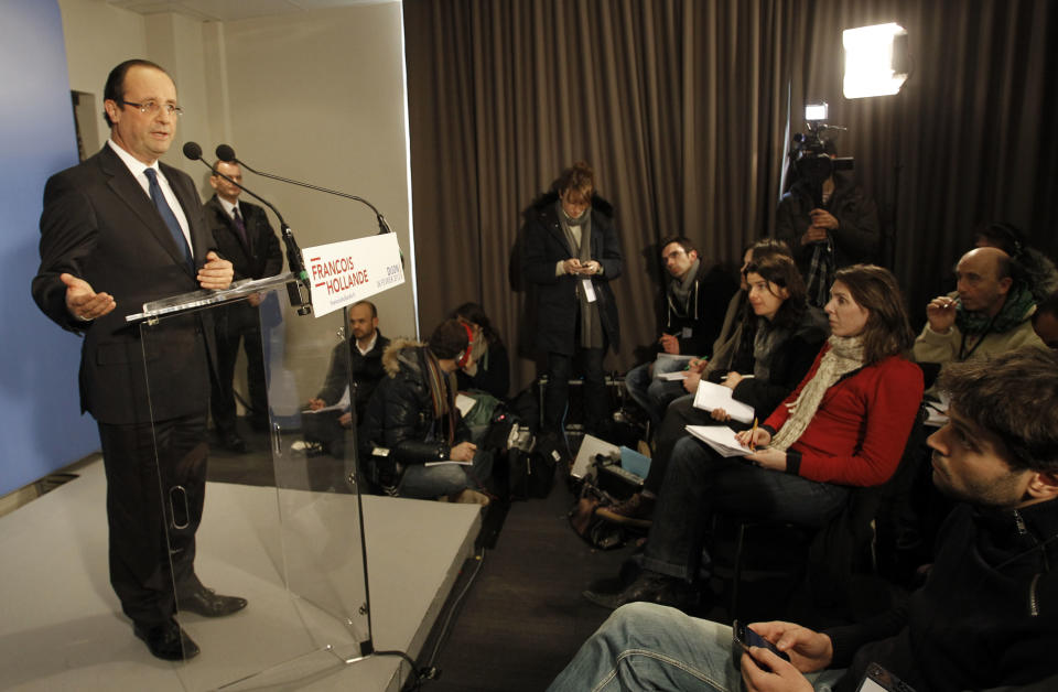 French Socialist Party candidate for the 2012 presidential elections Francois Hollande delivers a speech to journalists during a press conference in Dijon, central France, Monday, Feb. 6, 2012. (AP Photo/Christophe Ena)