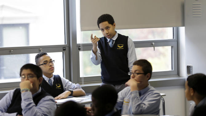 In this Oct. 23, 2013 photo, eighth-grader Elijah Landsman answers a question in a humanities class at Eagle Academy in New York, Wednesday, Oct. 23, 2013. The all-male model of the academy, once seen as sexist and outdated, has been resurrected to serve a population of youths who advocates feared were likelier headed to prison than to college. (AP Photo/Seth Wenig)