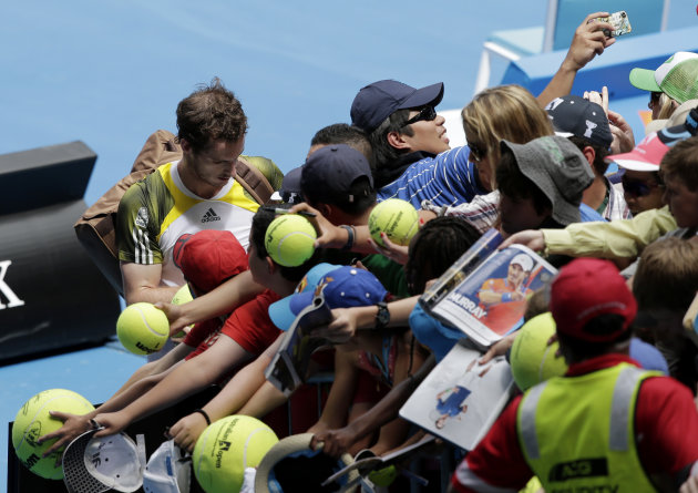Britain's Andy Murray signs autographs following his win over Portugal's Joao Sousa in their second round match at the Australian Open tennis championship in Melbourne, Australia, Thursday, Jan. 17, 2