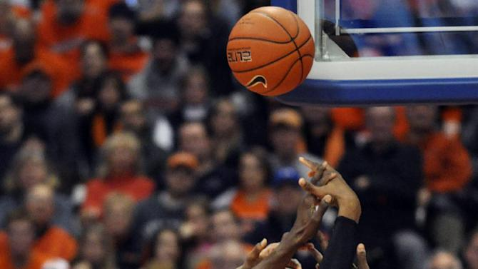 Rutgers' Kadeem Jack, center, battles Syracuse's Jerami Grant, left, and Baye Moussa Keita (12) for a loose ball during the first half of an NCAA college basketball game in Syracuse, N.Y., Wednesday, Jan. 2, 2013. (AP Photo/Kevin Rivoli)