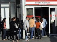 People wait in line at a government employment office in Madrid on Tuesday. Spain&#39;s jobless queue grew to 4.63 million people in August, the government said Tuesday, grim news for an economy suffering nearly 25-percent unemployment