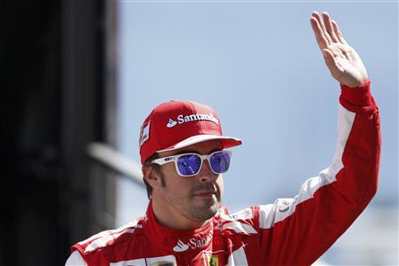 Ferrari Formula One driver Fernando Alonso of Spain waves during the third practice session of the Monaco F1 Grand Prix
