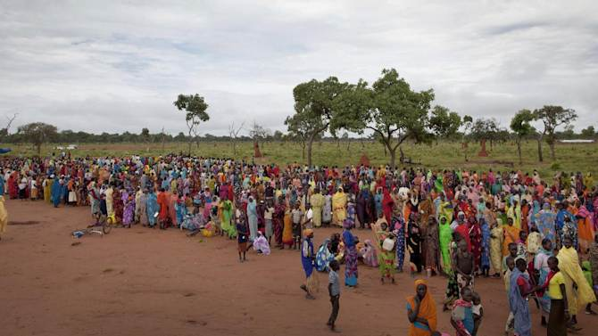 FILE - In this photo taken Saturday, Sept. 15, 2012, refugees wait in line to receive packages of food that had been air-dropped by the World Food Programme (WFP) the previous day, in Yida camp, South Sudan. Newly arrived refugees at the camp along the volatile South Sudan-Sudan border say renewed fighting between rebels and Sudan's military is likely to send thousands more people to the expanding camp there filled with refugees of war and hunger. (AP Photo/Mackenzie Knowles-Coursin, File)