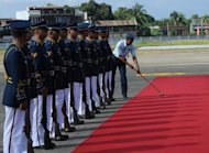 A Philippine airforce soldier cleans a red carpet in front of an honor guard on July 5. Shorter people now have a chance to rise to the highest positions in the Philippines armed forces after the country's top military academy lowered its height requirement on Friday