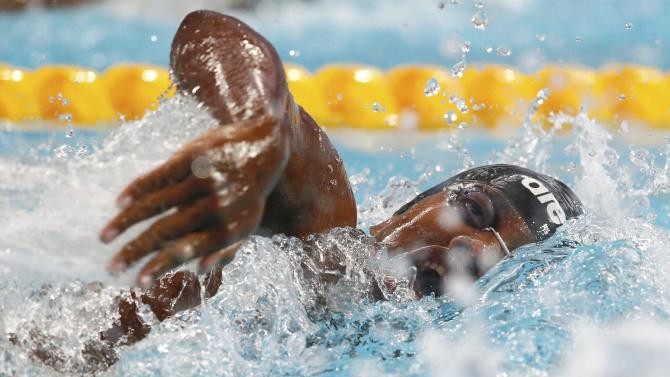 Burundi's Ganira swims in men's 100m freestyle heat at Aquatics World Championships in Kazan