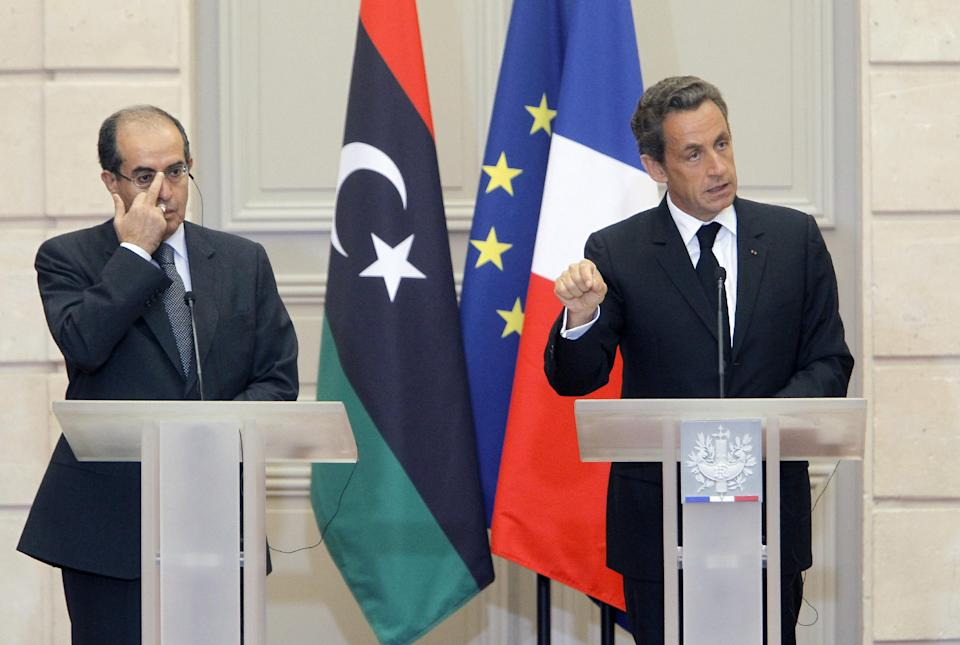 France's President Nicolas Sarkozy, right, reacts with  the head of Libya's opposition government Mahmoud Jibril during at their meeting at the Elysee Palace in Paris. Wednesday, Aug. 24, 2011. (AP Photo/Jacques Brinon)