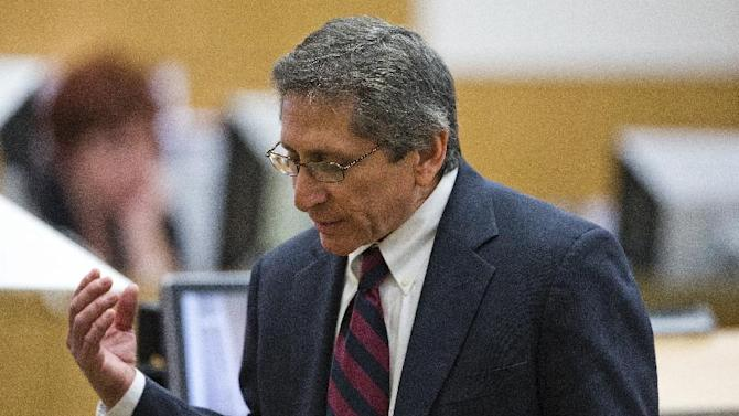 Prosecutor Juan Martinez asks Jodi Arias about a photo she took of Travis Alexander in the shower, moments before she allegedly shot him, stabbed him and slit his throat, during her murder trial on Thursday, Feb. 28, 2013 in Phoenix. Arias, 32, is charged in the June 2008 killing her lover, Alexander, in his suburban Phoenix home. (AP Photo/The Arizona Republic, Tom Tingle, Pool)