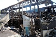 A Bulgarian Interior Ministry shows the wreckage of a bus in Borgas after an explosion on July 18. Bulgarian police along with the CIA, FBI and Interpol are struggling to identify a suicide bomber who killed six people, including five Israelis, as the United States said the attack bore the &quot;hallmarks&quot; of Hezbollah