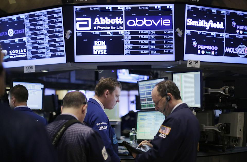 Stock traders work at the New York Stock Exchange, Monday, March 4, 2013 in New York. Uncertainty over the outcome of a budget battle in Washington pushed world stock markets lower on Monday. (AP Photo/Mark Lennihan)