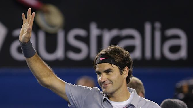 Switzerland's Roger Federer waves to the crowd after his fourth round win over Canada's Milos Raonic at the Australian Open tennis championship in Melbourne, Australia, Monday, Jan. 21, 2013. (AP Photo/Dita Alangkara)