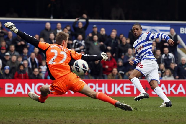 Queens Park Rangers' Remy scores past Sunderland's goalkeeper Mignolet during their English Premier League soccer match in London