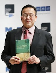 "Malaysian author Tan Twan Eng holding his book ""The Garden of Evening Mists"" in London on October 15, 2012. A debut novel and a work by a Nobel laureate were among five books shortlisted for Asia's most prestigious literary prize on Wednesday, with entries across the region from Turkey to Japan"