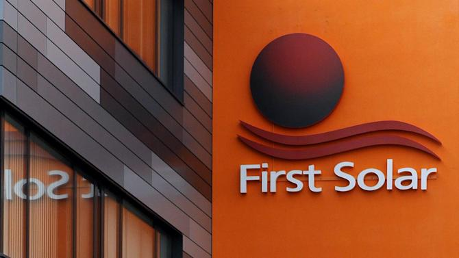 FILE -  In this Feb. 23, 2012 file photo the company logo is pictured on a building of First Solar in Frankfurt/Oder, eatsern Germany. First Solar Inc. says it's shuttering its manufacturing operations at Frankfurt an der Oder in Germany due to deteriorating market conditions in Europe and to reduce costs. The Tempe, Arizona-based company said Tuesday, April 17, 2012 it will also indefinitely idle four production lines in Malaysia. (AP Photo/dapd,Theo Heimann, File)
