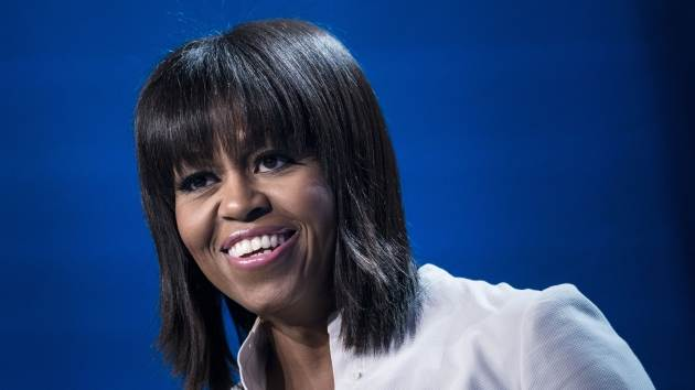 First Lady Michelle Obama smile while speaking during the Kids' Inaugural concert at the Washington Convention Center January 19, 2013 in Washington, DC -- Getty Premium