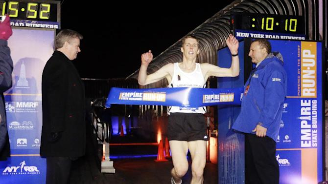 Mark Bourne, of Australia, wins the men's invitational race of the Empire State Building Run-Up, Wednesday, Feb. 6, 2013, in New York. (AP Photo/Frank Franklin II)