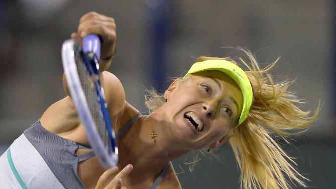 Maria Sharapova, of Russia, serves to Sara Errani, of Italy, during their match at the BNP Paribas Open tennis tournament, Wednesday, March 13, 2013, in Indian Wells, Calif. (AP Photo/Mark J. Terrill)