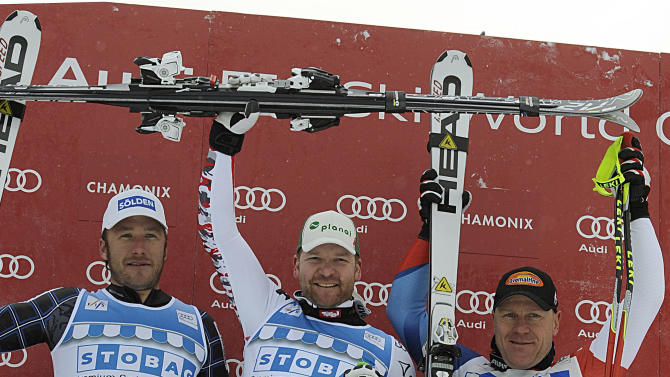 Austria's Klaus Kroell, center, winner of an alpine ski, men's World Cup downhill, celebrates on the podium with second placed Bode Miller, of the United States, left, and third placed Didier Cuche, of Switzerland, in Chamonix, France, Friday, Feb. 3, 2012. (AP Photo/Alessandro Trovati)