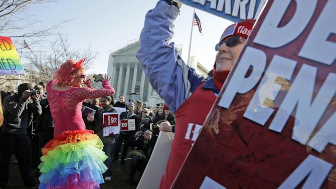 Qween Amar from Orlando, Fla., left, dances by Margie Phelps, right, a member of the Westboro Baptist Church, outside the Supreme Court in Washington, Tuesday, March 26, 2013, where the court will hear arguments on California's voter approved ban on same-sex marriage, Proposition 8. (AP Photo/Pablo Martinez Monsivais)