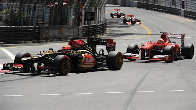 Lotus F1 Team's Finnish driver Kimi Raikkonen and Ferrari's Spanish driver Fernando Alonso compete during the Monaco Grand Prix (AFP)