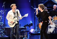 Guitarist Dan Auerbach of The Black Keys, left, and singer Mick Jagger of The Rolling Stones perform together at the Prudential Center in Newark, NJ on Saturday, Dec. 15, 2012. (Photo by Evan Agostini/Invision/AP)