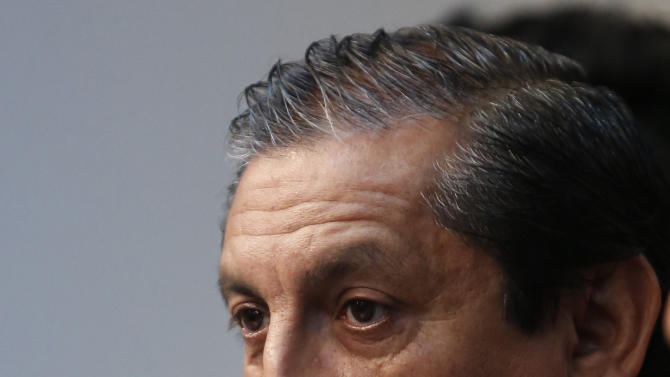 Argentina's Ramon Diaz, the new coach for Paraguay's national soccer team, gives a press conference to introduce the members of his technical team in Asuncion, Paraguay, Thursday, Dec. 18, 2014. He named Argentines Emiliano Diaz, Andres Silvera, Jorge Pidal and Damian Paz. (AP Photo/Jorge Saenz)