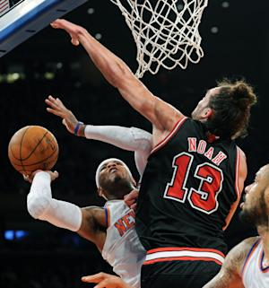 New York Knicks' Carmelo Anthony, left, attempts a shot as Chicago Bulls' Joakim Noah defends during the first quarter of an NBA basketball game Friday, Jan. 11, 2013, at Madison Square Garden in New York. (AP Photo/Bill Kostroun)