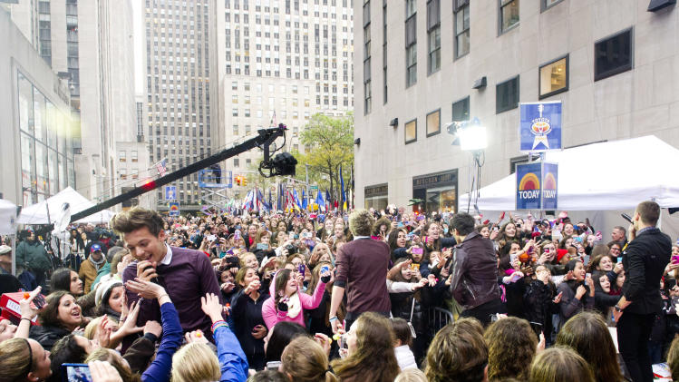 "One Direction member Louis Tomlinson, left, performs on NBC's ""Today"" show on Tuesday, Nov. 13, 2012 in New York. (Photo by Charles Sykes/Invision/AP)"