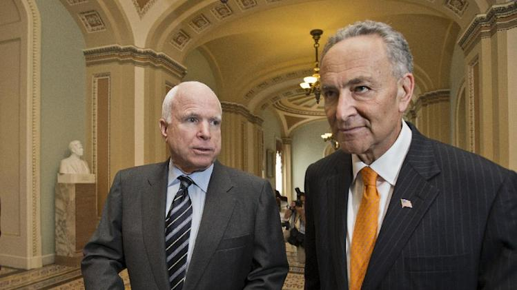 "Sen. John McCain, R-Ariz., left, and Sen. Charles Schumer, D-N.Y., right, two of the authors of the immigration reform bill crafted by the Senate's bipartisan ""Gang of Eight,"" confer on Capitol Hill in Washington, Thursday, June 27, 2013, prior to the final vote. The historic legislation would dramatically remake the U.S. immigration system and require a tough new focus on border security. (AP Photo/J. Scott Applewhite)"