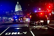 US President Barack Obama&#39;s motorcade drives down Pennsylvania Avenue enroute to the US Capitol for the State of the Union address in Washington, DC, February 12, 2013