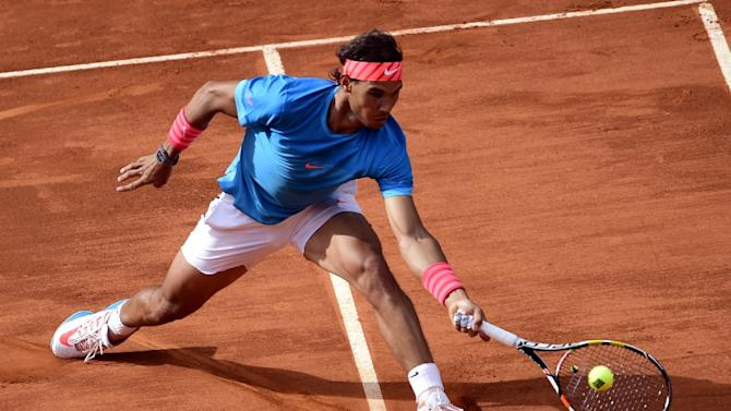 Rafael Nadal of Spain hits a return to Steve Johnson of the US during the Madrid Open, at the Caja Magica (Magic Box) sports complex, on May 6, 2015