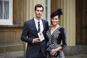 Wimbledon champion Murray poses with his girlfriend and his OBE medal in London