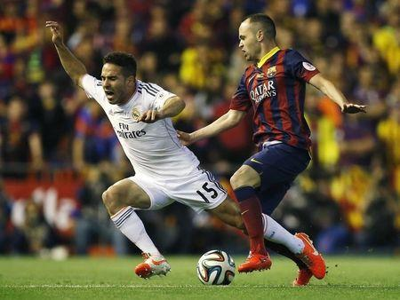Barcelona's Andres Iniesta (R) and Real Madrid's Daniel Carvajal challenge for the ball during their King's Cup final soccer match at Mestalla stadium in Valencia