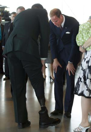 The Duke of Cambridge inspects the artificial leg of MCPL Jody Mitic while meeting with veterans at the War Museum in Ottawa on Saturday July 2, 2011.  (AP Photo/The Canadian Press, Frank Gunn)