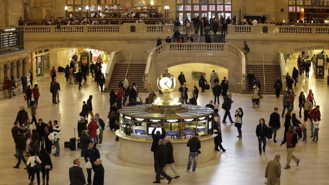 FILE- In this Jan. 9, 2013 file photo, pedestrians and travelers stroll through the main concourse of Grand Central Terminal in New York. The landmark, one of the country's finest examples of Beaux Arts architecture and the most famous train station in America is celebrating it's 100th anniversary on February 1. (AP Photo/Kathy Willens, File)