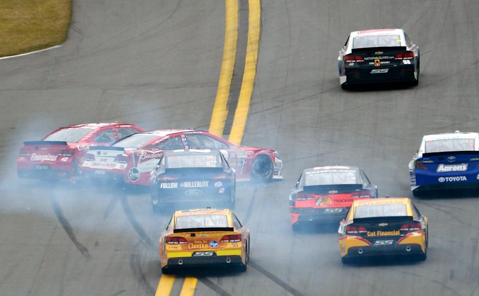Juan Pablo Montoya (42) and Kevin Harvick (29) collide while going into Turn 1 during the NASCAR Daytona 500 Sprint Cup Series auto race at Daytona International Speedway in Daytona Beach, Fla., Sunday, Feb. 24, 2013. (AP Photo/Phelan M. Ebenhack)