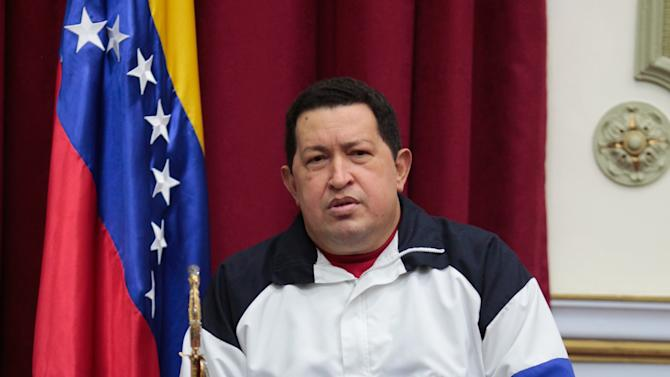 In this photo released by Miraflores Press Office, Venezuela's President Hugo Chavez holds a sword that once belonged to independence hero Simon Bolivar at a meeting with his Cabinet, at Miraflores Presidential palace in Caracas, Venezuela, Monday, Dec 10, 2012.  Chavez met with his Cabinet Monday morning, prior to his departure to Cuba for a third cancer operation.  For the first time, Chavez has designated a political heir, who said that if he suffers complications, Vice President Nicolas Maduro should be elected as Venezuela's leader to continue his socialist movement. (AP Photo/Miraflores Press Office, Marcelo Garcia)