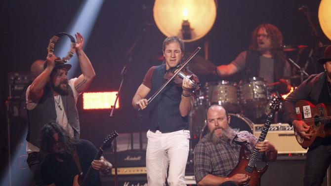 Members of the Zac Brown Band perform during the 2014 iHeartRadio Music Festival in Las Vegas