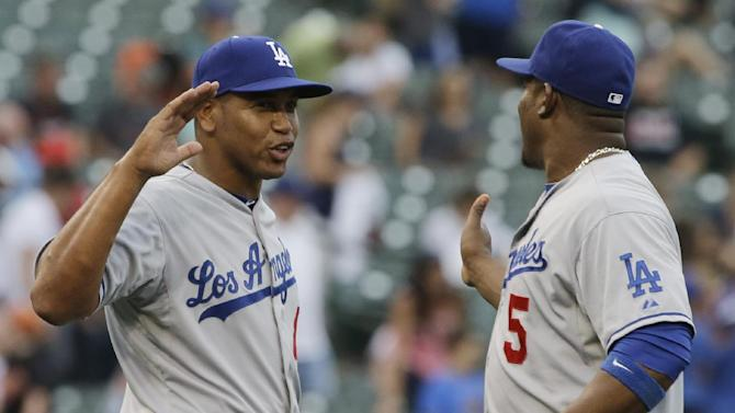 Dodgers win to match club-record road streak at 12