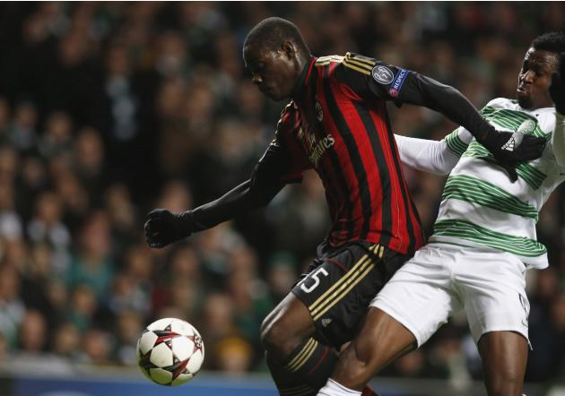 AC Milan's Balotelli shrugs off the challenge of Celtic's Ambrose to score during their Champions League soccer match in Celtic Park Stadium, Glasgow
