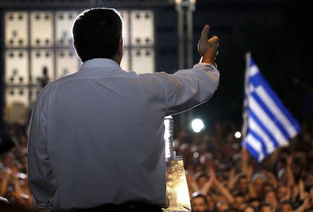 Greek Prime Minister Alexis Tsipras delivers a speech at an anti-austerity rally in Syntagma Square in Athens