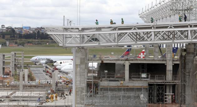 Labourers work on the extensive renovations at Sao Paulo International airport in Guarulhos
