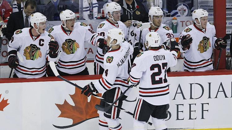 Blackhawks score 3 straight to down Jets 5-1