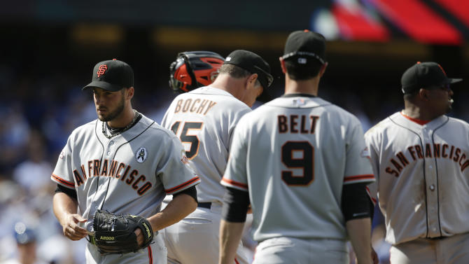 San Francisco Giants relief pitcher George Kontos, left, walks off the mound after he was relieved during the eighth inning of a season-opening baseball game against the Los Angeles Dodgers in Los Angeles, Monday, April 1, 2013. The Dodgers won 4-0. (AP Photo/Jae C. Hong)