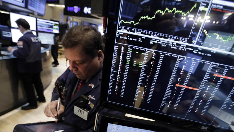 Trader John Santiago works on the floor of the New York Stock Exchange Monday, Jan. 27, 2014. Shaky economies and currencies in emerging markets are prompting more declines in global markets, following a rout last week (AP Photo/Richard Drew)