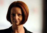 Australian Prime Minister Julia Gillard has attacked Queensland officials over their handling of a massive Indian-led US$6.3 billion coal mine project, accusing them of risking investor confidence