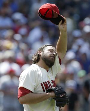 Cleveland Indians relief pitcher Chris Perez wipes sweat from his forehead after giving up a solo home run to Seattle Mariners' Raul Ibanez in the ninth inning of a baseball game, Saturday, May 18, 2013, in Cleveland. The Indians won 5-4. (AP Photo/Tony Dejak)
