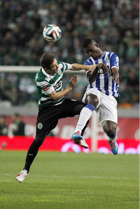 Sporting's Diego Capel, left, from Spain, tussles for the ball with Porto's Silvestre Varela during the Portuguese league soccer match between Sporting and Porto at Sporting's Alvalade sta