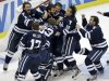 Yale goalie Jeff Malcolm (33) is swarmed by teammates after shutting out Quinnipiac  and leading the Bulldogs to a 4-0 win in the NCAA men&#39;s college hockey national championship game in Pittsburgh Saturday, April 13, 2013.  (AP Photo/Gene Puskar)